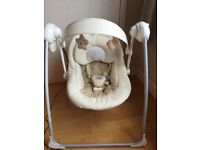 Baby cream swing. Suitable for a boy or a girl. Plays different tunes& can change speed of swing