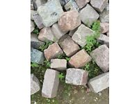 Rose coloured Granite sets in assorted sizes including a number of Granite edgings.