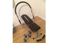 Excercise bench with abs cruncher and small weights 4kg and 8kg.
