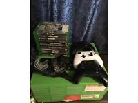 Xbox one includes 3 controllers charge kit with plenty of games headset etc!