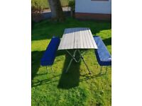 camping or picnic table with benches
