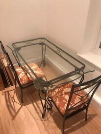 Large metal and glass table with 4 chairs