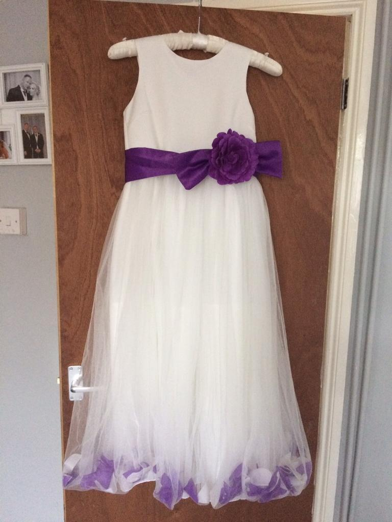 Wedding/Party dress age 12in Norwich, NorfolkGumtree - BHS wedding collection dress age 12, with Cadbury purple sash belt and petals Petals are loose in the netting so move when they walk Worn once for a wedding all washed and ready to go