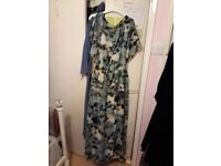 Maxi dress with design slits on shoulder area. Brilliant quality, stylish, worn once. Size 12-14.