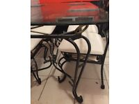 Excellent condition glass dining table and four chairs very heavy and sturdy lovely set