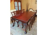 Dining table and 8 chairs (2 carvers) Solid mahogany, wonderful condition. Chippendale style.