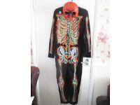 NEW boys fancy dress/halloween skeleton costume GLOW IN THE DARK size 13-14 yrs