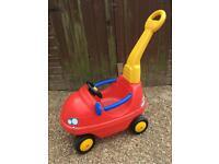 Children's car with parental handle