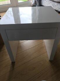 Small white high gloss unit
