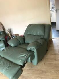 2 reclining chairs and a reclining sofa