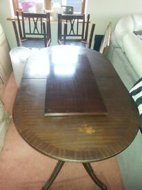Wooden Dining table and 6 matching chairs