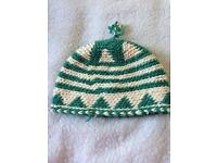 Green and white alpaca wool hat