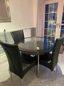 Glass round table and 4 chairs and gloss cabinet