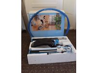 Tacx trainer, wheel riser and 700 x 23 training tyre.. Used three times, as new boxed.