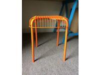 Orange metal stool