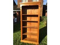 Solid pine bookcase with adjustable height shelves. I can deliver