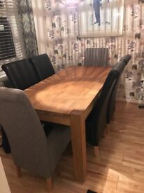 Oak table and chairs 2 grey fabric and 4 leatherette chairs