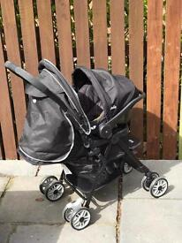 Joie pushchair with carry seat and rain cover.