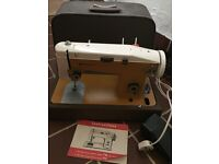 Sterling Sewing Machine with original instructions.