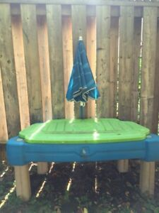 Sand and water table with umbrella