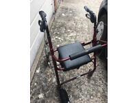 Wheeled walking frame with seat