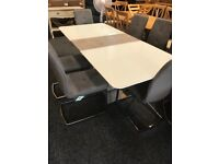 Modern exDisplay dining table and six grey modern chairs