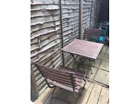 Outdoor patio table and two chairs wooden