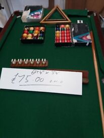 Pool Table complete with cue , 2 sets of Balls 1 Pool, 1 Snooker,2 triangles and cover