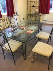 Glass table 6 chairs with matching bakers rack