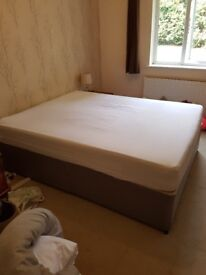 Kind size duvan bed and mattress with no headboard.
