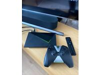 Nvidia Shield TV 4K box and remote + controller.