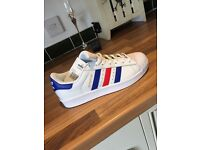 White Adidas Superstars with blue and red stripe, limited edition