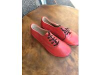 new and unworn ladies size4 red leather flat shoes