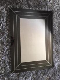 Bespoke black glass mirror