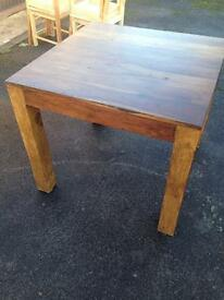 Chunky square dark wood dining table