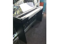 Yamaha Piano sized keyboard with stand