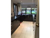 High gloss cream and black/wood affect kitchen