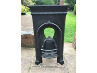 Small Victorian cast iron fireplace for sale.