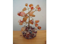 Amber coloured gemstones tree set in a mixed gemstone circular base. Excellent condition. £4 ovno.