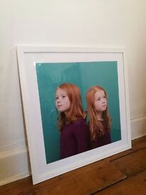 Three large white frames