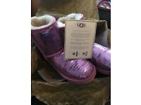 Girls pink sequi UGG boots UK size 2