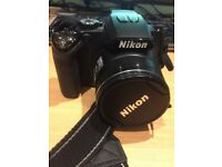 Nikon Coolpix P100 10 MP Digital Camera with 26x Optical Zoom Lens £65 ovno