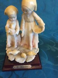 G Armani figurine