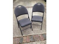 Pair of padded folding chairs