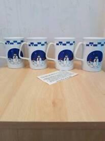 Brand new set of 4 snowman mugs
