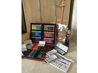 Artists equip. table top easel, water colour paints, pan sets, brushes, oil pastels, art pens etc