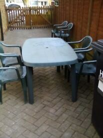Green patio table and 4 chairs
