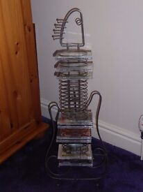 CD holder in the shape of a Guitar Rack In like new condition