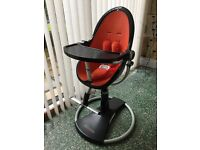 Bloom Fresco Highchair Black with Orange Seat pad and Harness. Extras - spare straps & baby snug