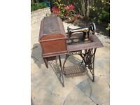 Vintage Singer sowing machine on treadle table